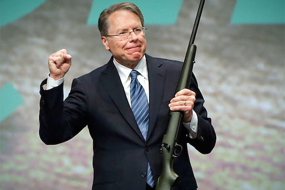 Executive Vice President of the NRA LaPierre holds a 300 Remington Ultra Mag that was auctioned off after he gave the keynote address at the Western Hunting and Conservation Expo in Salt Lake City, Utah
